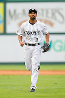 Charlotte Knights shortstop Marcus Semien (3) jogs off the field between innings of the International League game against the Lehigh Valley IronPigs at Knights Stadium on August 6, 2013 in Fort Mill, South Carolina.  The IronPigs defeated the Knights 4-1.  (Brian Westerholt/Four Seam Images)