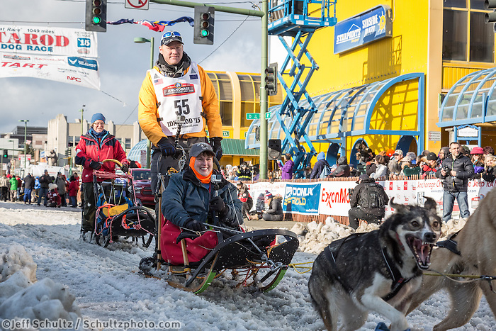 Mats Pettersson and team leave the ceremonial start line with an Iditarider at 4th Avenue and D street in downtown Anchorage, Alaska during the 2015 Iditarod race. Photo by Jim Kohl/IditarodPhotos.com