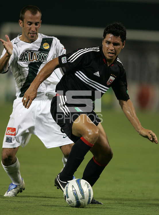 August 20, 2005: Washington, DC, USA: DC United midfielder Christian Gomez (10) tries to keep the ball away from  Los Angeles Galaxy midfielder Peter Vagenas (8) at RFK Stadium.