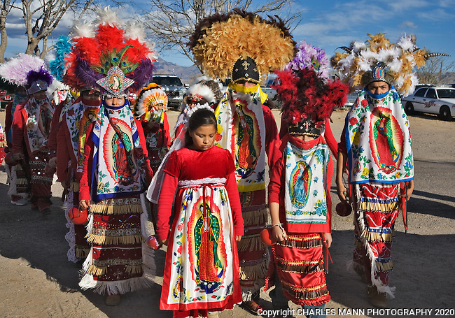 A group of red robed Danzantes march during the e Vigin of Guadalupe Feast Day celebration held in December at the village of Tortugas near Las Cruces, New Mexcio
