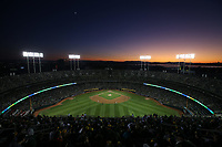 OAKLAND, CA - OCTOBER 02:  Fans sit in the upper deck in center field (Mt. Davis) at sunset during the American League Wild Card Game between the Tampa Bay Rays and Oakland Athletics at RingCentral Coliseum on Wednesday, October 2, 2019 in Oakland, California. (Photo by Brad Mangin)