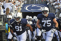 12 October 2013:  Penn State's DaQuan Jones (91) and Eric Shrive (75) run onto the field before the game . The Penn State Nittany Lions defeated the Michigan Wolverines 43-40 in 4OTs at Beaver Stadium in State College, PA.