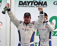 JC France  celebrates his podium finish in the Rolex 24 at Daytona , Daytona International Speedway, Daytona Beach, FL, January 2009.  )Photo by Brian Cleary)