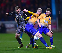 Lincoln City's Danny Rowe battles with  Mansfield Town's Neal Bishop, left, and Alex MacDonald<br /> <br /> Photographer Andrew Vaughan/CameraSport<br /> <br /> The EFL Sky Bet League Two - Mansfield Town v Lincoln City - Monday 18th March 2019 - Field Mill - Mansfield<br /> <br /> World Copyright © 2019 CameraSport. All rights reserved. 43 Linden Ave. Countesthorpe. Leicester. England. LE8 5PG - Tel: +44 (0) 116 277 4147 - admin@camerasport.com - www.camerasport.com