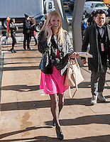 Fashionistas arrive in their finery outside of the Fall 2014 Fashion Week shows in Lincoln Center in New York, seen on opening day, Thursday, February 6, 2014. This year some designers are abandoning the tents at Lincoln Center to hold their shows at far flung venues, including Brooklyn.  (© Richard B. Levine)