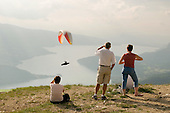 Hang gliders fly over Lake Annecy in the French Alps