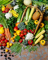 Agriculture - Mixed fruit and vegetables (tomatoes, bell peppers, carrots, broccoli, zucchini, crookneck squash, cauliflower, celery, spinach, sweet corn, green beans, English peas, papaya, mango, honeydew melons, pineapple, apricots, blackberries), in studio.