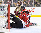 Johnny Gaudreau (BC - 13), Dan Cornell (Northeastern - 4), Clay Witt (Northeastern - 31) - The Boston College Eagles defeated the Northeastern University Huskies 7-1 in the opening round of the 2012 Beanpot on Monday, February 6, 2012, at TD Garden in Boston, Massachusetts.