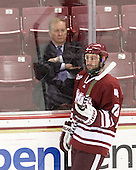 Jim Logue (BC - Assistant Coach) watches UMass warmup. - The Boston College Eagles defeated the University of Massachusetts-Amherst Minutemen 6-5 on Friday, March 12, 2010, in the opening game of their Hockey East Quarterfinal matchup at Conte Forum in Chestnut Hill, Massachusetts.