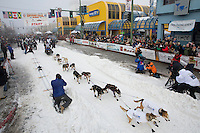 Scott Janssen leaves the ceremonial start line of the Iditarod sled dog race in downtown Anchorage Saturday, March 2, 2013. ..Photo (C) Jeff Schultz/IditarodPhotos.com  Do not reproduce without permission