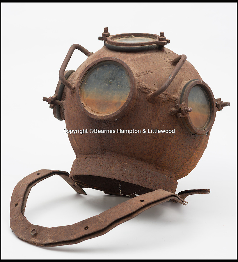 BNPS.co.uk (01202 558833)<br /> Pic: BHandI/BNPS<br /> <br /> A homemade diving helmet which was dug up in a garden of a house in Devon.<br /> <br /> A British couple's lifetime hobby of deep sea diving is set to make them a breathtaking £500,000 when they sell one of the world's finest collection of vintage diving helmets.<br /> <br /> Anthony and Yvonne Pardoe amassed over 150 heavyweight copper helmets worn by divers during the early days of underwater excavation.<br /> <br /> Weighing about 55lbs, the dome-shaped helmets bolted onto a copper collar of a diving suit and had a hose attached to the rear to provide air supply from the surface.<br /> <br /> They are being sold in Devon next month.