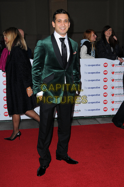 JIMI MISTRY .The Co-operative Variety Club Showbiz Awards, Grosvenor House Hotel, Park Lane, London, England, UK, .14th November 2010. .full length green jacket black trim tie suit velvet hands in pockets .CAP/CAS.©Bob Cass/Capital Pictures.