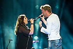 Hillary Scott and Charles Kelley of Lady Antebellum perform at LP Field during Day 2 of the 2013 CMA Music Festival in Nashville, Tennessee.