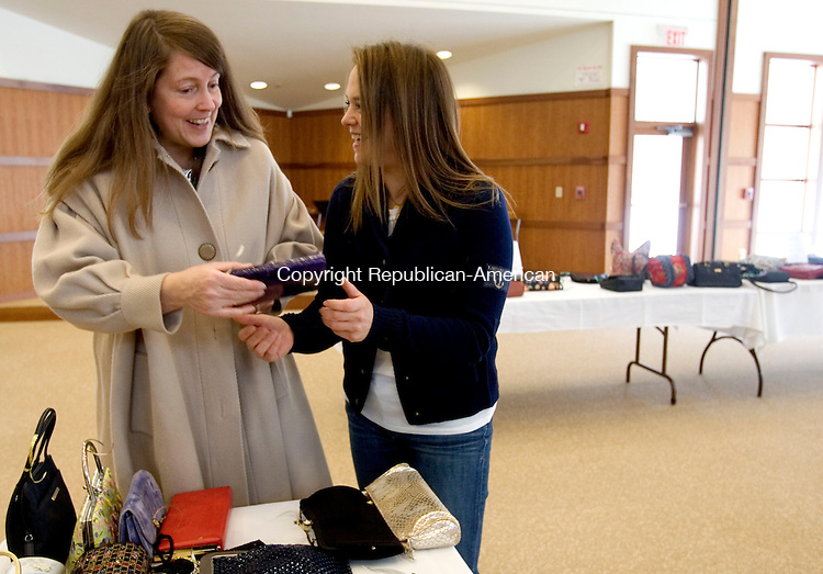 SOUTHBURY CT. 08 February 2014-020914SV01-From left, Karen Reddington-Hughes of Woodbury and Beth Rosen of Southbury shop at the Bags and Baubles Fundraiser sponsored by the Sisterhood of B'nai Israel  at B'nai Israel in Southbury Sunday. <br /> Steven Valenti Republican-American