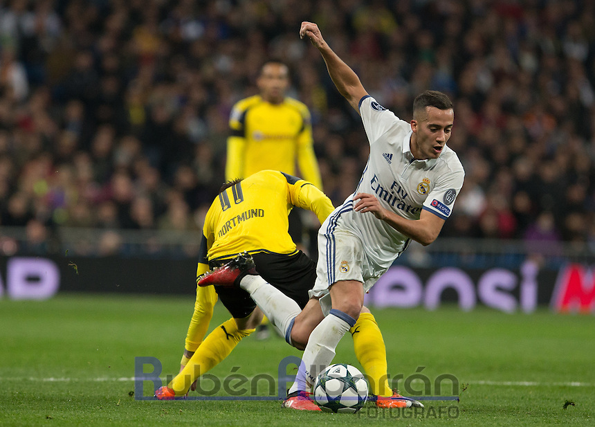 Real Madrid's Spanish forward Lucas Vazquez and  Aubameyang of Borussia Dortmund during the UEFA Champions League match between Real Madrid and Borussia Dortmund at the Santiago Bernabeu Stadium in Madrid, Tuesday, December 7, 2016.