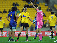 Conrad Smith questions referee Mike Fraser during the Super Rugby match between the Hurricanes and Highlanders at Westpac Stadium, Wellington, New Zealand on Saturday, 6 July 2013. Photo: Dave Lintott / lintottphoto.co.nz