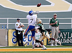 Kansas Jayhawks wide receiver Kale Pick (7) goes for a pass while getting defended by Baylor Bears cornerback Joe Williams (22) during the game between the Kansas Jayhawks and the Baylor Bears at the Floyd Casey Stadium in Waco, Texas. Baylor leads Kansas 20 to 14 at halftime....