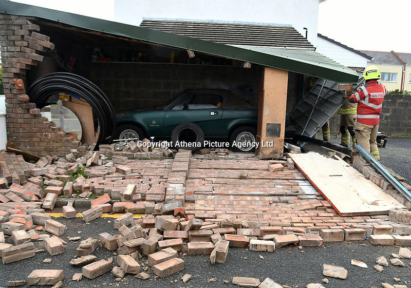 Pictured: Fire service officers secure a garage with a Triumph TR7 inside, which was damaged by strong winds caused by storm Callum , in the Llanion area of Pembroke Dock, west Wales, UK. Friday 12 October 2018<br /> Re: Strong winds and rain caused by Storm Callum in south Wales, UK.