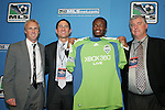15 January 2009: Steve Zakuani (ENG) was selected with the first overall draft pick by expansion team Seattle Sounders FC. With Technical Director Chris Henderson (l), owner Adrian Hanauer, and head coach Sigi Schmid (r). The 2009 Major League Soccer SuperDraft was held at the Convention Center in St. Louis, Missouri in conjuction with the National Soccer Coaches Association of America's annual convention.