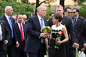 United States President Donald J. Trump walks through Section 60 after he participates in a wreath-laying ceremony at the Tomb of the Unknown Soldier at Arlington National Cemetery on Memorial Day , May 29, 2017 in Arlington, Virginia. <br /> Credit: Olivier Douliery / Pool via CNP