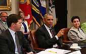 United States President Barack Obama meets with small business owners to discuss the importance of the reauthorization of the Export-Import Bank in the Roosevelt Room of the White House on July 22, 2015, in Washington, DC. He is flanked by Paul Sullivan, Vice President of International Business Development Acrow Bridges on his left,  and Susan Jaime, Founder Ferra Coffee on his right.  <br /> Credit: Aude Guerrucci / Pool via CNP