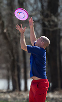 NWA Democrat-Gazette/BEN GOFF @NWABENGOFF<br /> Kyle White catches a pass Thursday, March 8, 2018, during the Northwest Arkansas Ultimate lunch break pickup game at Phillips Park in Bentonville. The group holds pickup games each weekday and on Saturdays at the park when weather allows.