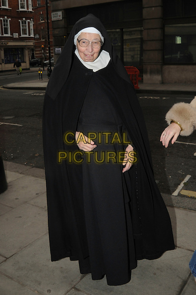 SISTER WENDY BECKETT  .leaving  BBC Radio 2, London, England, UK, 11th December 2010..full length nun habit black .CAP/IA.©Ian Allis/Capital Pictures.
