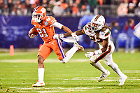 Charlotte, NC - DEC 2, 2017: Clemson Tigers wide receiver Ray-Ray McCloud (21) breaks the tackle of Miami Hurricanes defensive back Sheldrick Redwine (22) during ACC Championship game between Miami and Clemson at Bank of America Stadium Charlotte, North Carolina. (Photo by Phil Peters/Media Images International)