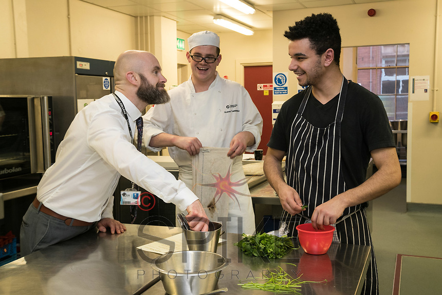 Chris Stamp, Restaurant Manager, wth students Konrad Tomkiewicz and Reece O'Flaherty, (right)