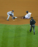 New York Yankees shortstop Derek Jeter takes a throw at second base while Scott Sizemore of the Detroit Tigers slides in safely with a stolen base during a game at Comerica Park in Detroit, Michigan on May 4, 2011.  (Photo by Bob Campbell)