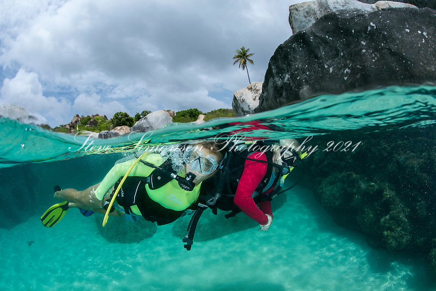 Scuba divers at The Baths<br /> split level view<br /> Virgin Gorda