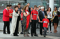 Pictured: Rhofdri Morgan's wife Julie (C) with Lorraine Barrett (L) surrounded by relatives after the service. Wednesday 31 May 2017<br />