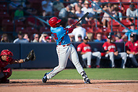 Spokane Indians first baseman Curtis Terry (28) follows through on his swing in front of catcher Yorman Rodriguez (13) during a Northwest League game against the Vancouver Canadians at Avista Stadium on September 2, 2018 in Spokane, Washington. The Spokane Indians defeated the Vancouver Canadians by a score of 3-1. (Zachary Lucy/Four Seam Images)