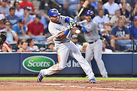Chicago Cubs shortstop Starlin Castro (13) swings at a pitch during a game against the Atlanta Braves on July 18, 2015 in Atlanta, Georgia. The Cubs defeated the Braves 4-0. (Tony Farlow/Four Seam Images)