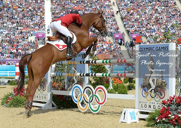 Werner Muff riding Kiamon (SUI, Switzerland). Team Showjumping - PHOTO: Mandatory by-line: Garry Bowden/SIP/Pinnacle - Photo Agency UK Tel: +44(0)1363 881025 - Mobile:0797 1270 681 - VAT Reg No: 768 6958 48 - 06/08/2012 - 2012 Olympics - Greenwich Park, London, England
