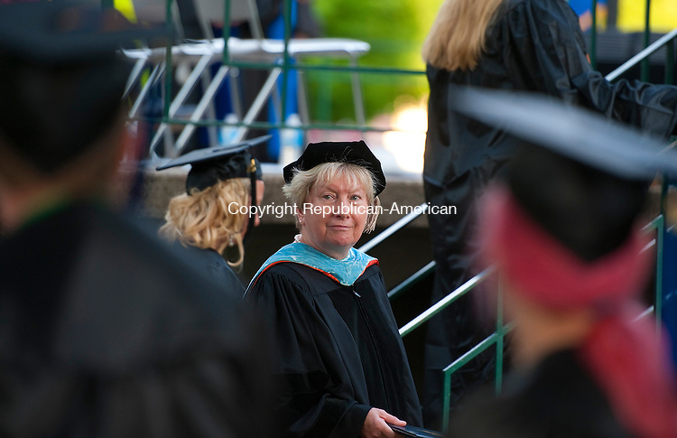 WINSTED, CT--052815JS08-  Der. Barbara Douglass, President of Northwestern Connecticut Community College, smiles as she walks by the graduates during graduation ceremonies Thursday at East End Park in Winsted. Dr. Douglass will be retiring late this year. <br />  Jim Shannon Republican-American
