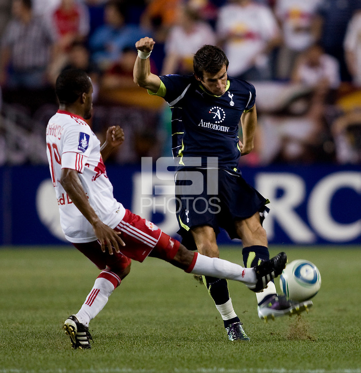 Gareth Bale (3) of Tottenham tries to punt the ball away from Dane Richards (19) of the New York Red Bulls during the Barclays New York Challenge at Red Bull Arena in Harrison, NY.  Tottenham defeated the New York Red Bulls, 2-1.