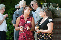 Occidental College faculty enjoy themselves during the Faculty Bar-B-Que at the Wallis Annenberg President's House on Monday, August 25, 2008. (Photo by Marc Campos, College Photographer)