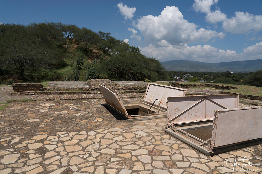 The entrances to Tomb 1 and Tomb 2 are in the floor of the former palace in the ruins of the Zapotec city of Zaachila in the Central Valley of Oaxaca, Mexico.