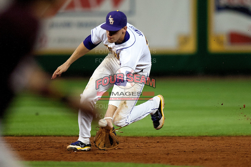 LSU Tigers second baseman JaCoby Jones #23 makes an error against the Mississippi State Bulldogs during the NCAA baseball game on March 16, 2012 at Alex Box Stadium in Baton Rouge, Louisiana. LSU defeated Mississippi State 3-2 in 10 innings. (Andrew Woolley / Four Seam Images)