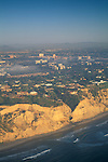 Aerial of coastal cliffs at sunset near Torrey+Pines, Northern San Diego Coastline San Diego County, CALIFORNIA