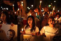 Phoenix, Arizona, USA--  Protestors attend a candle light vigil outside the Arizona State Capitol to protest SB1070. (Pat Shannahan/ The Arizona Republic)