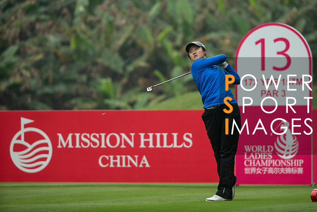 Liu Yu of China tees off at the 13th hole during Round 3 of the World Ladies Championship 2016 on 12 March 2016 at Mission Hills Olazabal Golf Course in Dongguan, China. Photo by Victor Fraile / Power Sport Images