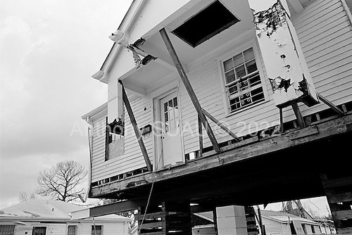 New Orleans, Louisiana.USA.July 28, 2006..A damaged home is raised on stilts to avoid future flooding after it was flooded in the London street canal district one year earlier by hurricane Katrina hit and the levees broke leaving 80% of the city flooded. The house is located very close to the London Street canal and was one of many homes in the neighborhood that had been raised...