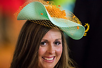 BALTIMORE, MD - MAY 20: A woman wearing a festive hat similes while in the grandstand on Preakness Stakes Day at Pimlico Race Course on May 20, 2017 in Baltimore, Maryland.(Photo by Douglas DeFelice/Eclipse Sportswire/Getty Images)