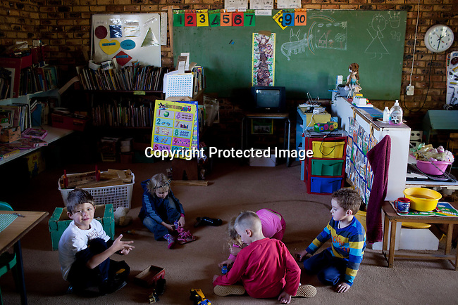 KLEINFONTEIN, SOUTH AFRICA - JULY 15: Children play play at the CVO school on July 15, 2013 in Kleinfontein outside Pretoria, South Africa. The all white town with about one thousand residents are all Afrikaners with a Vortrekker heritage. Only white Afrikaners who share Afrikaner culture, language and religion are allowed to settle in the town.   (Photo by: Per-Anders Pettersson)