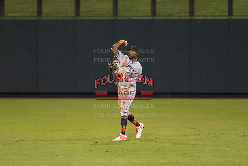 Scottsdale Scorpions center fielder Ronnie Dawson (4), of the Houston Astros organization, throws to the infield during an Arizona Fall League game against the Salt River Rafters at Salt River Fields at Talking Stick on October 11, 2018 in Scottsdale, Arizona. Salt River defeated Scottsdale 7-6. (Zachary Lucy/Four Seam Images)