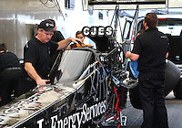 Mar 14, 2015; Gainesville, FL, USA; Crew members working on the car of NHRA top fuel driver Dave Connolly during qualifying for the Gatornationals at Auto Plus Raceway at Gainesville. Mandatory Credit: Mark J. Rebilas-