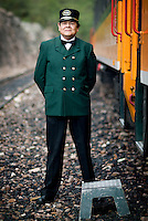 Train attendant Miguel Mando stands outside the First Express train at the Divisadero train stop in Copper Canyon, Mexico, Saturday, June 21, 2008. Traveling on the First Express train will lend to better service, a bar, and a faster trip through the canyon...PHOTOS/ MATT NAGER
