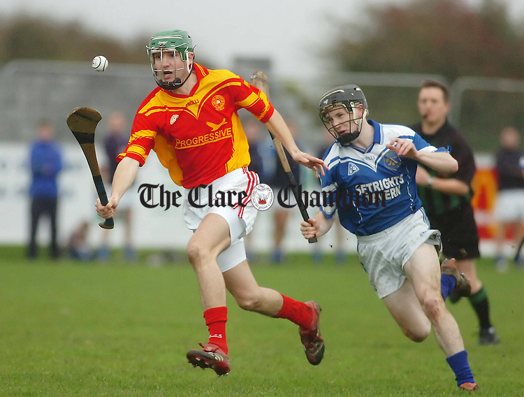 Smith O'Briens Shane O'Brien is chased down by Cratloes Ogie Murphy in the Senior B Hurling final at Shannon.Pic Arthur Ellis.